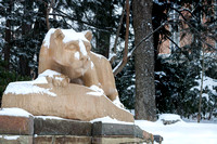 Snow falls on the Nittany Lion
