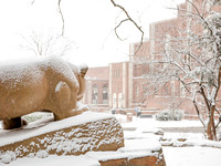 A Snow-Covered Nittany Lion Overlooks Rec Hall