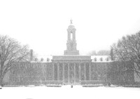 Penn State Old Main with snowfall, front view - Black and White
